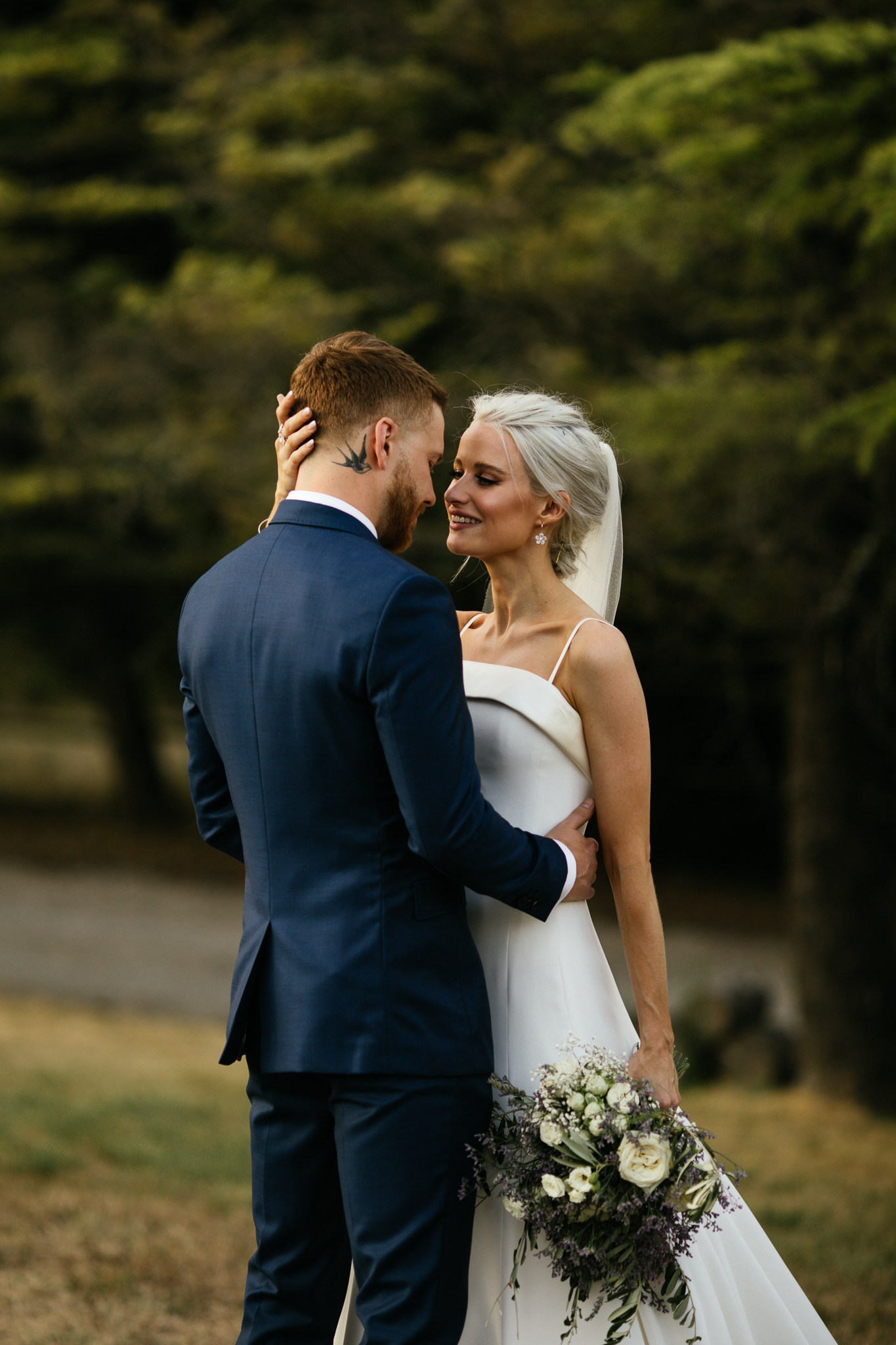 Victoria Magrath of inthefrow stands looking at her new husband in a Phillipa Lepley wedding gown on their wedding day.